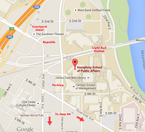 Google street map with conference venue, hotel, parking, and light rail station labeled.